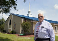 Pastor Dwight Allen of The Anchor Church of God, stands outside the church Tuesday, Aug. 10, 2021, in Callahan, Fla. Allen has been vaccinated and encourages his parishioners to do so as well. (AP Photo/John Raoux)
