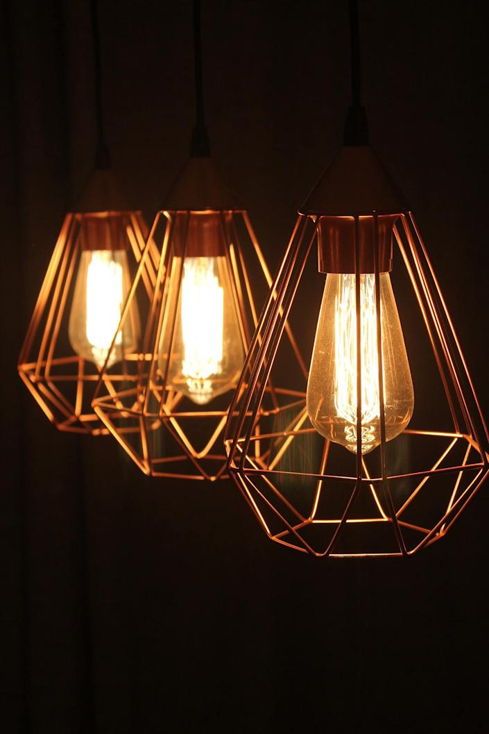 Geometric brass lamps like these make for tasteful modern additions to almost any home