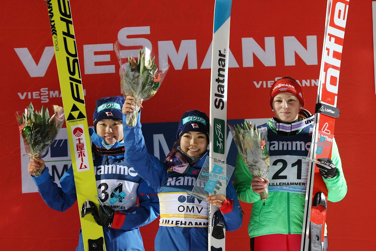 (L-R) Yuki Ito of Japan, Sara Takanashi of Japan and Anna Rupprecht of Germany at the podium after the Women's Cross Country Sprint event at the FIS Cross Country World Cup in Lillehammer, Norway on December 2, 2016. (AFP Photo/Geir OLSEN)