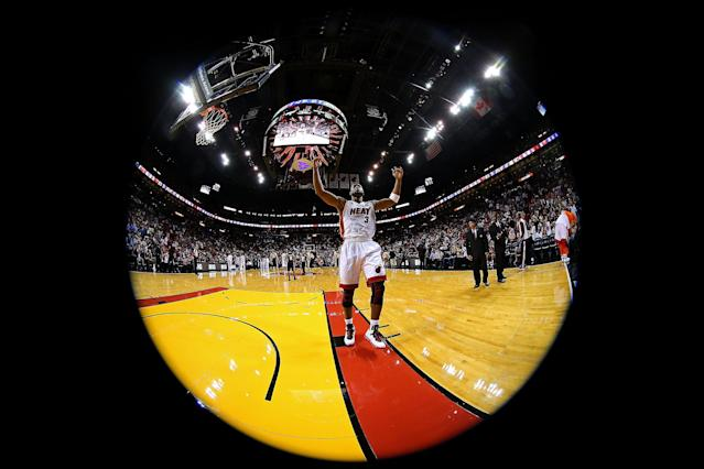 MIAMI, FL - NOVEMBER 29: (Editors Note: This images was created using a fisheye lens) Dwyane Wade #3 of the Miami Heat greets the crowd during a game against the San Antonio Spurs at American Airlines Arena on November 29, 2012 in Miami, Florida. (Photo by Mike Ehrmann/Getty Images)
