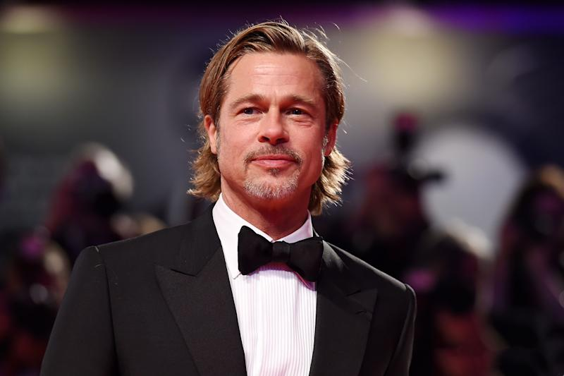 Brad Pitt asks astronaut: Who was better - me or George Clooney?