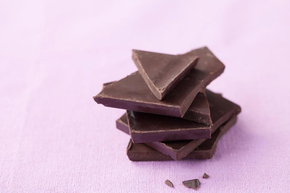 "<p>When you're craving chocolate, it may be your body's way of telling you that you need magnesium. Because one ounce of dark chocolate boasts <a href=""https://fdc.nal.usda.gov/fdc-app.html#/food-details/170273/nutrients"" class=""link rapid-noclick-resp"" rel=""nofollow noopener"" target=""_blank"" data-ylk=""slk:65 milligrams of the mineral"">65 milligrams of the mineral</a>, enjoying a piece during your period may help <a href=""http://pubmed.ncbi.nlm.nih.gov/2067759/"" class=""link rapid-noclick-resp"" rel=""nofollow noopener"" target=""_blank"" data-ylk=""slk:prevent mood swings"">prevent mood swings</a>, while satisfying your sweet tooth.</p>"