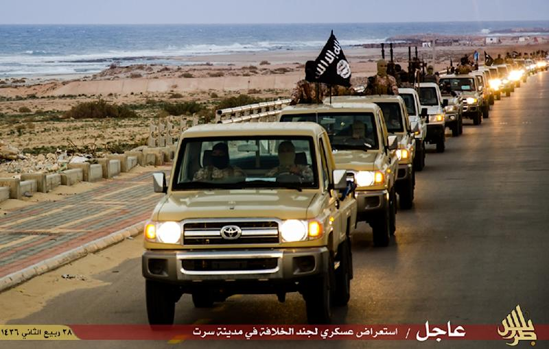 An image from Islamist media outlet Welayat Tarablos allegedly shows members of the Islamic State group parading in a street in Libya's coastal city of Sirte