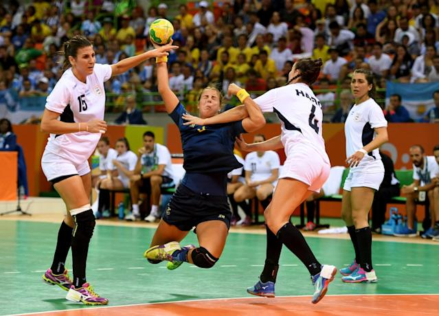 <p>Carin Stromberg of Sweden is blocked as she fires in a shot during the Sweden v Argentina Women's Handball match on Day 1 of the Rio 2016 Olympic Games at Future Arena on August 6, 2016 in Rio de Janeiro, Brazil. (Photo by Ross Kinnaird/Getty Images) </p>