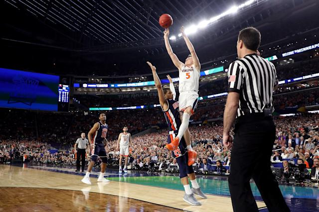 Virginia's Kyle Guy is fouled by Auburn's Samir Doughty in the final second of Saturday's Final Four game between the Cavaliers and Tigers. (Getty)