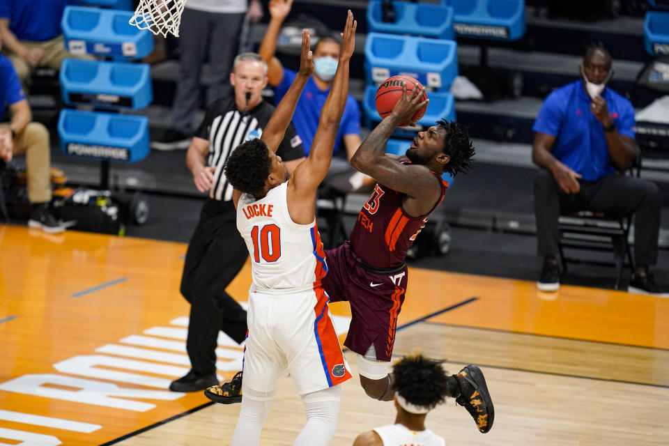 Virginia Tech Hokies guard Tyrece Radford (23) shoots over Florida guard Noah Locke (10) in the first half of a first round game in the NCAA men's college basketball tournament at Hinkle Fieldhouse in Indianapolis, Friday, March 19, 2021. (AP Photo/Michael Conroy)