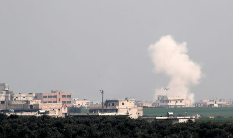 FILE PHOTO: Smoke rises after an air strike in Saraqeb in Idlib province