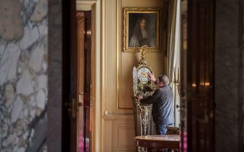 Julian Newman official timekeeper at Bleinham Palace is assigned the task of changing 30 historic clocks ready for daylight saving time - Credit: Paul Grover