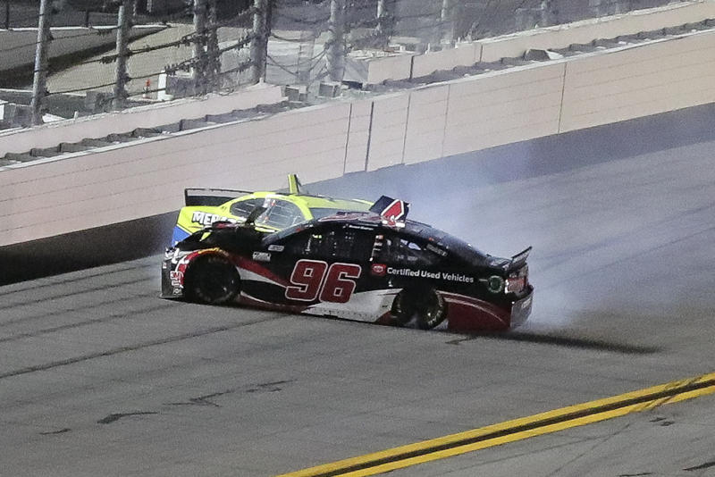 Daniel Suarez (96) and Ryan Blaney wreck as they come out of Turn 4 during the first of two NASCAR Daytona 500 qualifying auto races at Daytona International Speedway, Thursday, Feb. 13, 2020, in Daytona Beach, Fla. (AP Photo/David Graham)