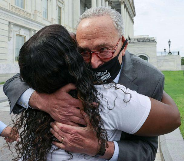 PHOTO: Senate Majority Leader Chuck Schumer hugs Rep. Cori Bush as they celebrate news that the White House intends to extend the eviction moratorium, outside the U.S. Capitol Building on Capitol Hill in Washington, Aug. 3, 2021. (Evelyn Hockstein/Reuters)