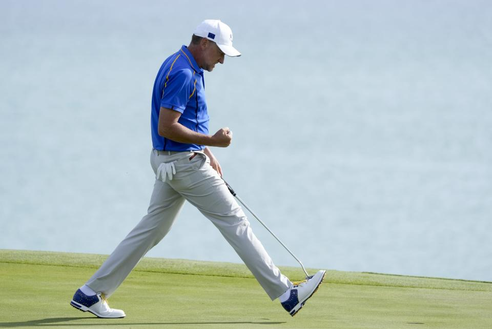 Team Europe's Ian Poulter reacts after making a putt on the 12th hole during a foursome match the Ryder Cup at the Whistling Straits Golf Course Friday, Sept. 24, 2021, in Sheboygan, Wis. (AP Photo/Charlie Neibergall)