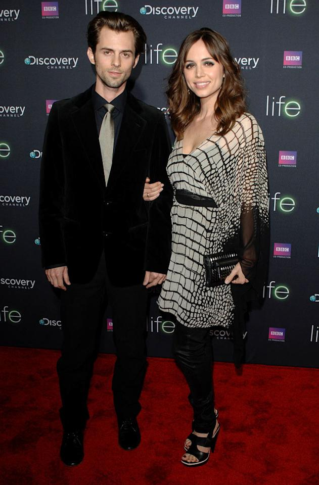 "<a href=""/eliza-dushku/contributor/31454"">Eliza Dushku</a> (right) and brother Nate Dushku arrive at Discovery Channel's Los Angeles Screening of <a href=""/life/show/44198"">""Life""</a> at the Getty Center on February 25, 2010."