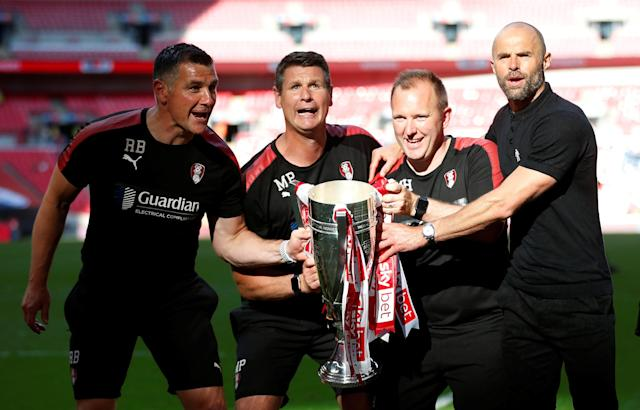 "Soccer Football - League One Play-Off Final - Rotherham United v Shrewsbury Town - Wembley Stadium, London, Britain - May 27, 2018 Rotherham manager Paul Warne and backroom staff celebrate winning the League One Play-Off Final with the trophy Action Images/Carl Recine EDITORIAL USE ONLY. No use with unauthorized audio, video, data, fixture lists, club/league logos or ""live"" services. Online in-match use limited to 75 images, no video emulation. No use in betting, games or single club/league/player publications. Please contact your account representative for further details."