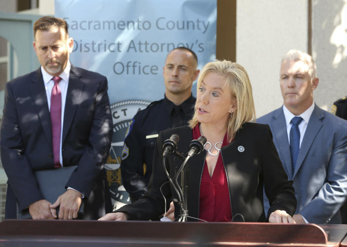 CORRECTS ARREST DAY OF WEEK TO THURSDAY, INSTEAD OF WEDNESDAY Sacramento County District Attorney Anne Marie Schubert, discusses the arrest of Roy Charles Waller, who is suspected of committing a series or rapes, during a news conference Friday, Sept. 21, 2018, in Sacramento, Calif. Waller, 58, was taken into custody in Berkeley by Sacramento Police, Thursday, Sept. 20, 2018, and faces multiple counts of rapes that occurred in Northern California starting in 1991. In the background are from left, is Brian Staebell, Sonoma County chief deputy district attorney, Sacramento Police Sgt. Vance Chandler and Jeff Reisig, Yolo County District Attorney, right, (AP Photo/Rich Pedroncelli)