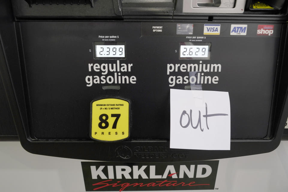 A note posted at a gas pump indicates the pump is out of premium gasoline at a Costco Warehouse fuel station, Tuesday, May 11, 2021, in Ridgeland, Miss. State officials warn that any shortages seen at individual gas stations are a result of people