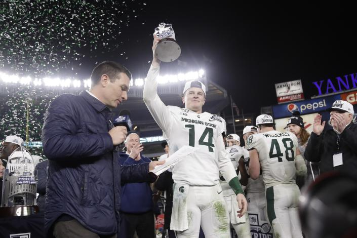 Michigan State's Brian Lewerke was named the MVP of the Pinstripe Bowl after he threw for over 300 yards. (AP Photo/Frank Franklin II)