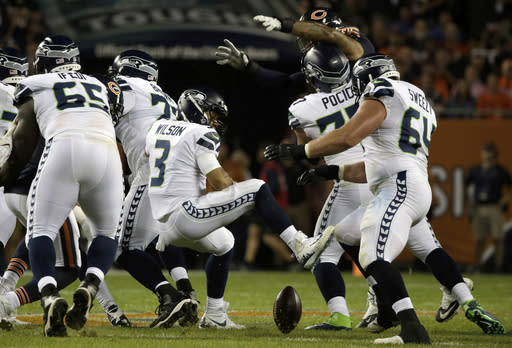 Seattle Seahawks quarterback Russell Wilson (3) loses a ball during the first half of an NFL football game against the Chicago Bears Monday, Sept. 17, 2018, in Chicago. (AP Photo/David Banks)