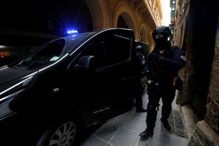 Armed police officers of the Malta Police Special Intervention Unit provide security as three men, accused of the assassination of anti-corruption journalist Daphne Caruana Galizia, arrive for their lawyers' submissions for bail at the Courts of Justice in Valletta, Malta April 17, 2018. REUTERS/Darrin Zammit Lupi