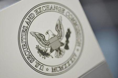 FILE PHOTO - The U.S. Securities and Exchange Commission logo adorns an office door at the SEC headquarters in Washington