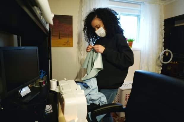 CUTLINE: Kelly Lacroix's basement has now become a space where she does her school work and sewing for Kind to Curls.