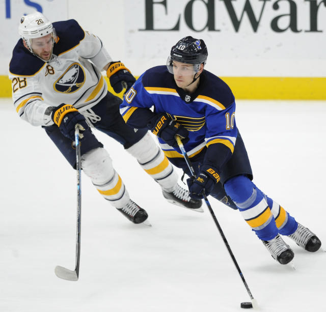 Buffalo Sabres' Zemgus Girgensons (28), of Latvia, chases St. Louis Blues' Brayden Schenn (10) during the third period of an NHL hockey game, Thursday, Dec. 27, 2018, in St. Louis. (AP Photo/Bill Boyce)