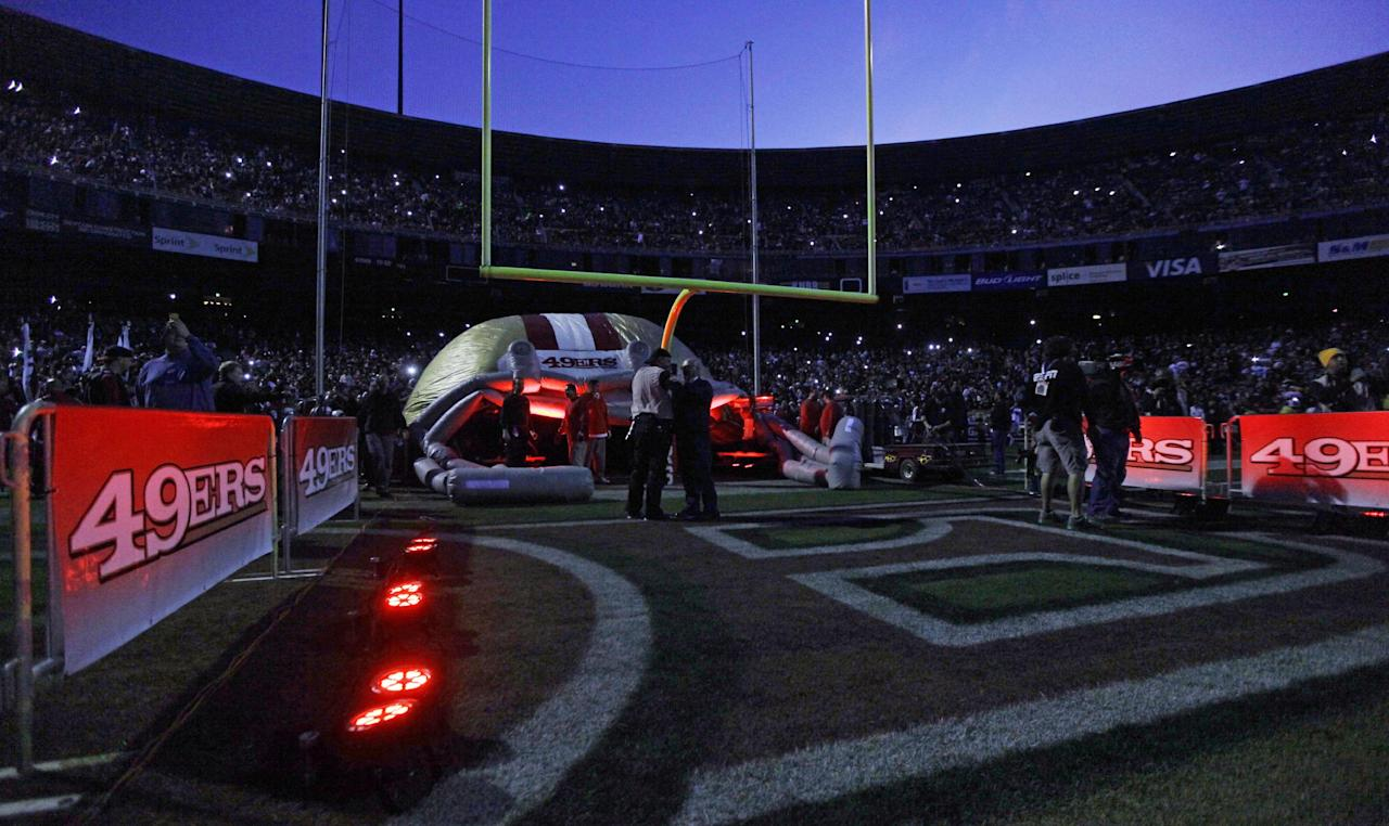 Fans and officials wait in Candlestick Park stadium during a power outage before an NFL football game between the San Francisco 49ers and the Pittsburgh Steelers in San Francisco, Monday, Dec. 19, 2011. (AP Photo/Marcio Jose Sanchez)