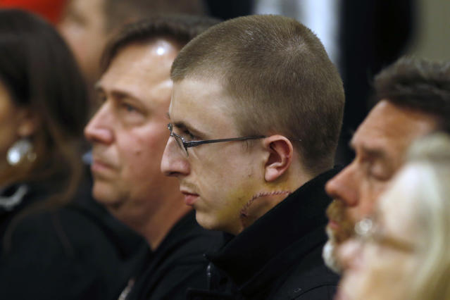 <p>Micah Fletcher, a victim of a stabbing attack on a light rail train that left two dead, watches as suspect Jeremy Christian is arraigned in Multnomah County Circuit Court in Portland, Ore., Tuesday, May 30, 2017. (Beth Nakamura/The Oregonian via AP, Pool) </p>