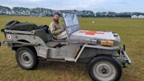 """<p>Once on the ground, it's the 1940s, starting with being picked up in an old Willys for the short ride to the gate. Jeeps get credit for helping win the war, but riding in the back of one is as brutal as having to fight on another front. The Revival also taught us that the English farmers who created the original Land Rover, copied off the Jeep, might have felt the same way. I feel like I can admit, as a proud American, the <a href=""""https://www.caranddriver.com/news/a15047638/land-rover-begins-restoration-of-land-rover-series-i-number-one/"""" rel=""""nofollow noopener"""" target=""""_blank"""" data-ylk=""""slk:Series I Landie"""" class=""""link rapid-noclick-resp"""">Series I Landie</a> is so much nicer to ride in.</p>"""