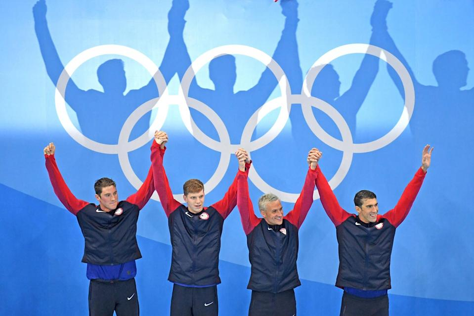 <p>Gold medalist Townley Haas, Conor Dwyer, Ryan Lochte and Michael Phelps of the United States celebrate on the podium during the medal presentation for the Men's 4 x 200m Freestyle Relay Final on Day 4 of the Rio 2016 Olympic Games at the Olympic Aquatics Stadium on August 9, 2016 in Rio de Janeiro, Brazil. (Photo by Richard Heathcote/Getty Images) </p>