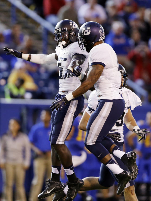 Utah State safety Maurice Alexander, left, celebrates after an interception with teammate Terrell Thompson, right, against San Jose State during the first half of an NCAA college football game Friday, Sept. 27, 2013, in San Jose, Calif. (AP Photo/Marcio Jose Sanchez)