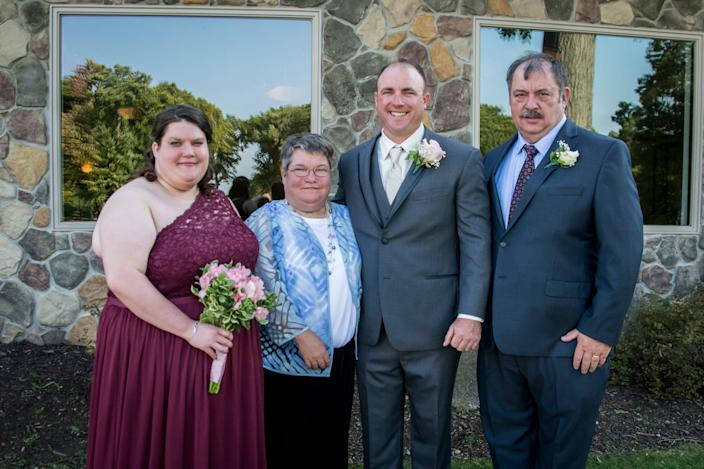"The Malinowski family at the wedding of Frank ""Keith"" Malinowski, second from right, including his father Frank, on right, sister Jamie, and mother Jody."