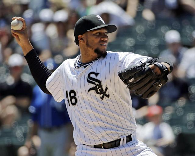 Chicago White Sox starter Hector Noesi throws against the Kansas City Royals during the first inning of a baseball game in Chicago on Saturday, June 14, 2014. (AP Photo/Nam Y. Huh)
