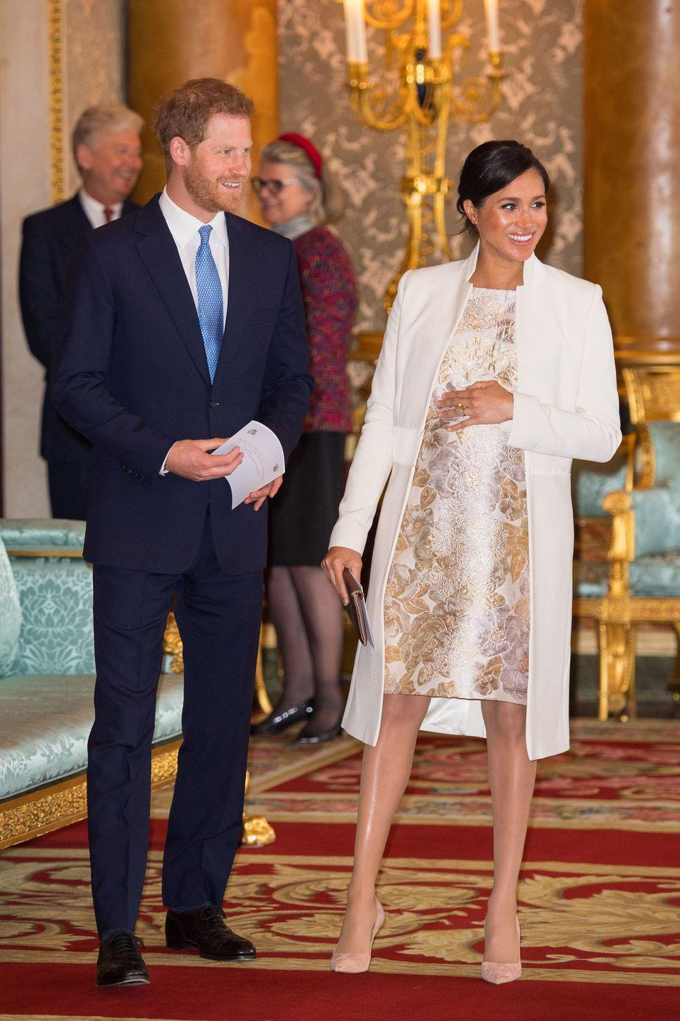 <p>Harry shares a laugh with Meghan as they attend a reception to mark the 50th anniversary of the investiture of the Prince of Wales at Buckingham Palace.</p>