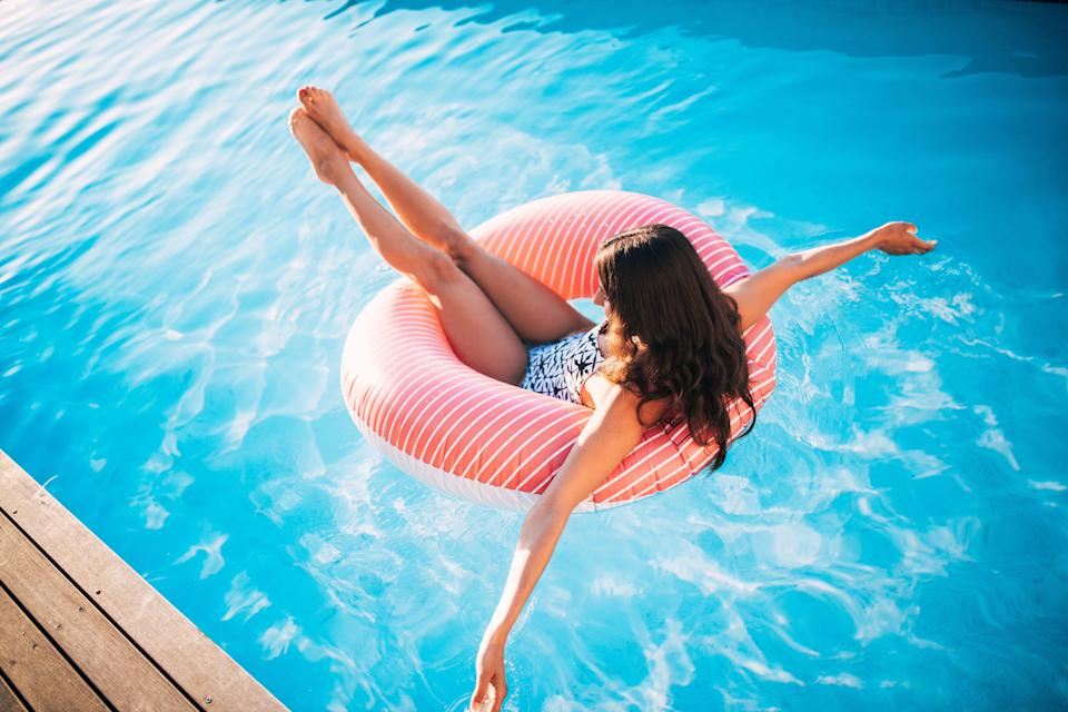 Woman in the pool in a pool ring