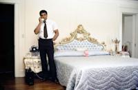 <p>Muhammad Ali in his bedroom in his Hancock Park home, just before his big fight with Larry Holmes in 1980. Please note the pink stuffed animal on the bed. </p>