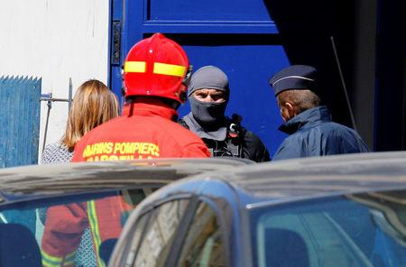 """French firefighters and police and members of special Police units RAID conduct an investigation after two Frenchmen were arrested in Marseille, France, April 18, 2017 for planning to carry out an """"imminent and violent attack"""" ahead of the first round of the presidential election on Sunday, France's interior minister said. REUTERS/Philippe Laurenson"""