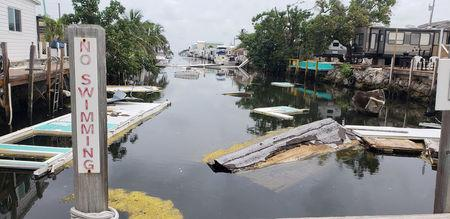A debris-filled canal is seen, almost a year after Hurricane Irma, in Marathon, Florida, U.S., June 10, 2018.  Picture taken June 10, 2018.  REUTERS/Zach Fagenson