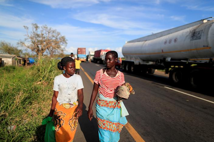 Jofresse walks with her neighbor near a camp for the displaced. (Photo: Zohra Bensemra/Reuters)