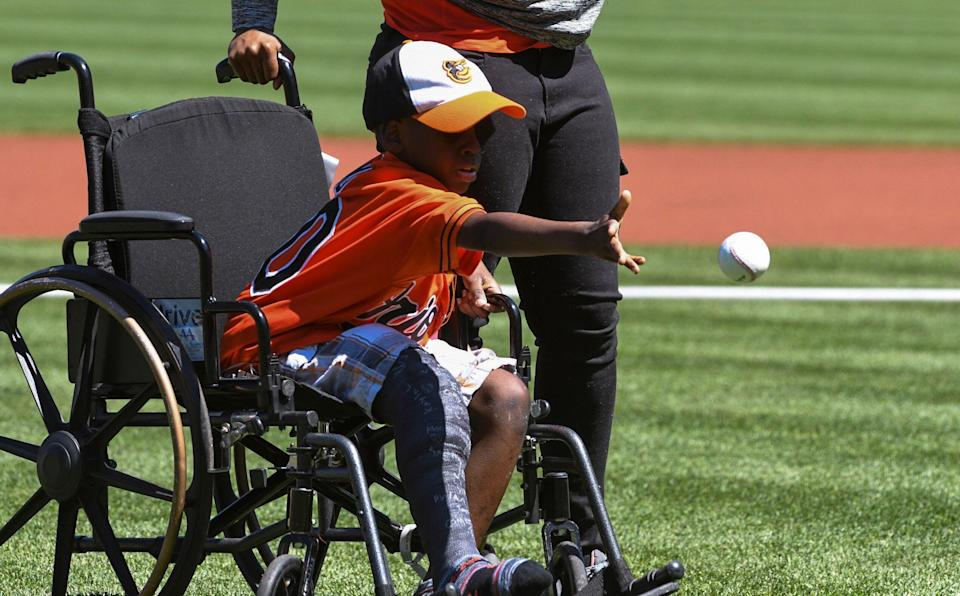 Ravens fan Mo Gaba, shown here at a Baltimore Orioles game, became the first person to read an NFL draft card written in Braille on Saturday. (Getty Images)