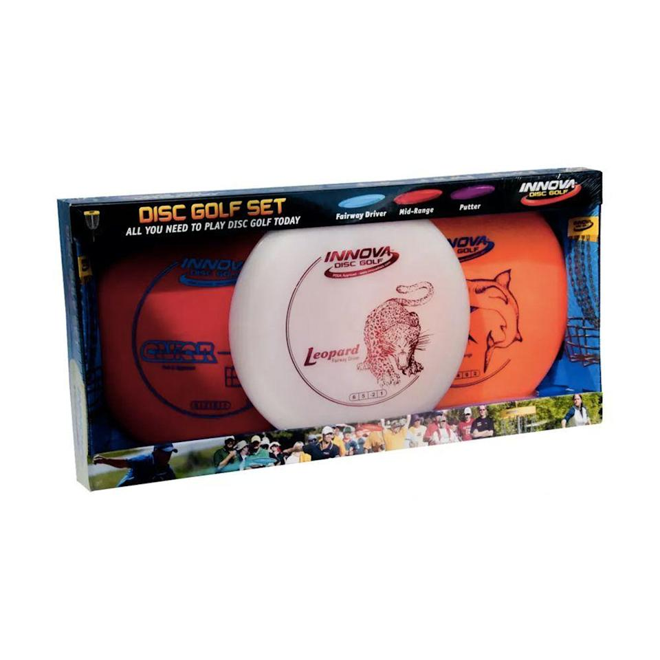 """<p><strong>Innova Disc Golf</strong></p><p>dickssportinggoods.com</p><p><strong>$27.99</strong></p><p><a href=""""https://go.redirectingat.com?id=74968X1596630&url=https%3A%2F%2Fwww.dickssportinggoods.com%2Fp%2Finnova-disc-golf-dx-3-disc-set-16ivaudx3dscstxxxstg%2F16ivaudx3dscstxxxstg&sref=https%3A%2F%2Fwww.bestproducts.com%2Ffitness%2Fequipment%2Fg36863790%2Fbest-disc-golf-sets%2F"""" rel=""""nofollow noopener"""" target=""""_blank"""" data-ylk=""""slk:Shop Now"""" class=""""link rapid-noclick-resp"""">Shop Now</a></p><p>If you're new to the game, this starter set is your ticket. It's Innova's most popular disc golf set, which includes a driver, midrange, and putter. All three discs are specifically designed with beginner-friendly weight, comfortable grip, and solid performance in variable weather conditions.</p>"""