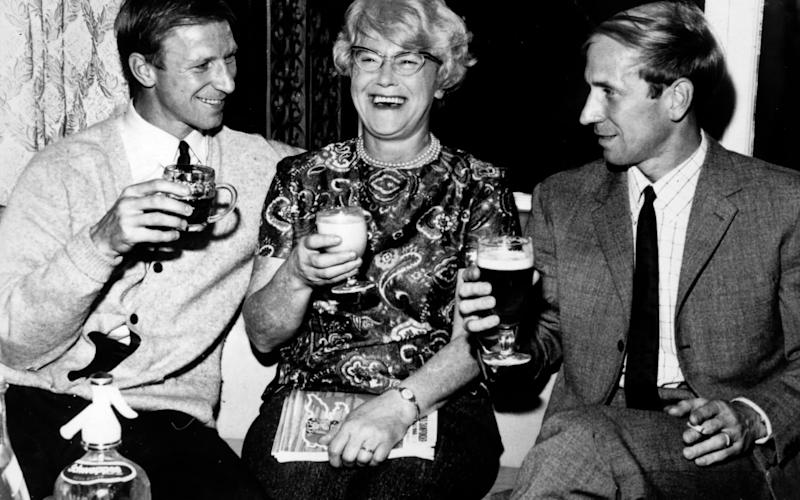 Jack, left, and Bobby Charlton enjoy a celebration drink with their mother Cissie after the World Cup Semi-Final win over Portugal at Wembley - Popperfoto via Getty Images