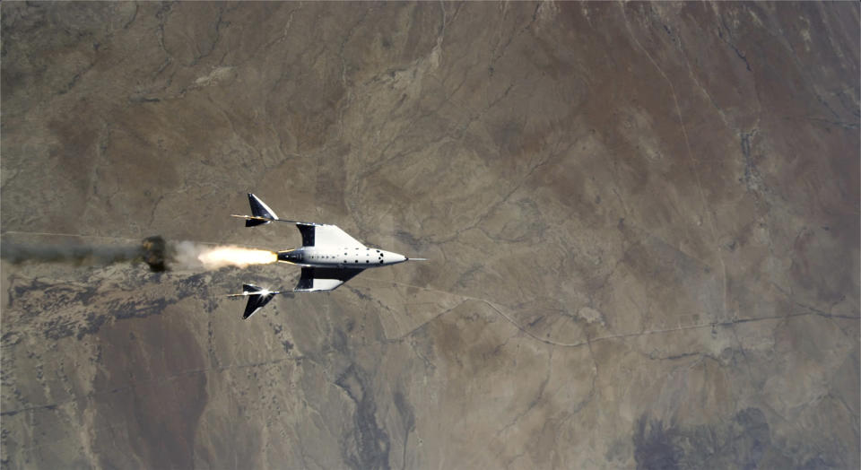 FILE - This Saturday, May 22, 2021 image provided by Virgin Galactic shows the release of VSS Unity from VMS Eve and ignition of the rocket motor over Spaceport America, N.M. After reaching nearly 50,000 feet (15,000 meters), Unity will be released from the specially designed aircraft, and drop for a moment or two before its rocket motor ignites to send the craft on a steep climb toward space. (Virgin Galactic via AP, File)