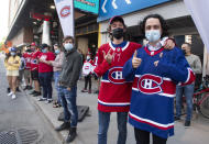 FILE - Fans wait for players to arrive at the Bell Centre before Game 6 of an NHL hockey Stanley Cup first-round playoff series between the Toronto Maple Leafs and the Montreal Canadiens in Montreal, in this May 29, 2021, file photo. The Montreal Forum, iconic shrine where the Canadiens hoisted 12 of their 24 Cups has been turned into a multiplex theater. The Canadiens have since moved to the Bell Centre, which hosting its first Cup Final series. (Ryan Remiorz/The Canadian Press via AP, File)