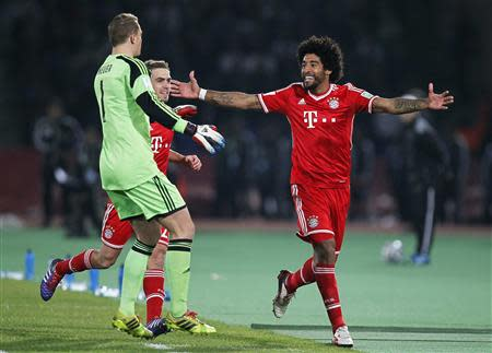 Dante (R) of Germany's Bayern Munich celebrates his goal against Morocco's Raja Casablanca during their 2013 FIFA Club World Cup final match at Marrakech stadium December 21, 2013. REUTERS/Louafi Larbi