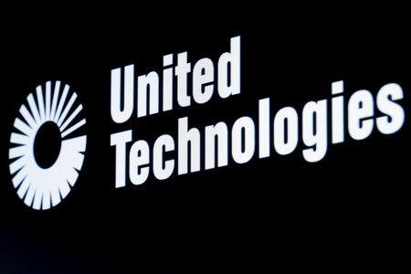 The ticker symbol for for United Technologies is displayed at the post where it is traded  on the floor of the NYSE