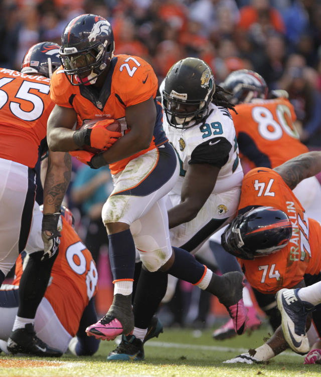 Denver Broncos running back Knowshon Moreno (27) crosses over the goal line on a 1-yard touchdown run against the Jacksonville Jaugars in the third quarter of an NFL football game, Sunday, Oct. 13, 2013, in Denver. (AP Photo/Joe Mahoney)