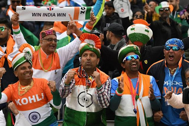 Indian supporters celebrate in the crowd during the World Cup match against Pakistan (AFP Photo/Oli SCARFF)