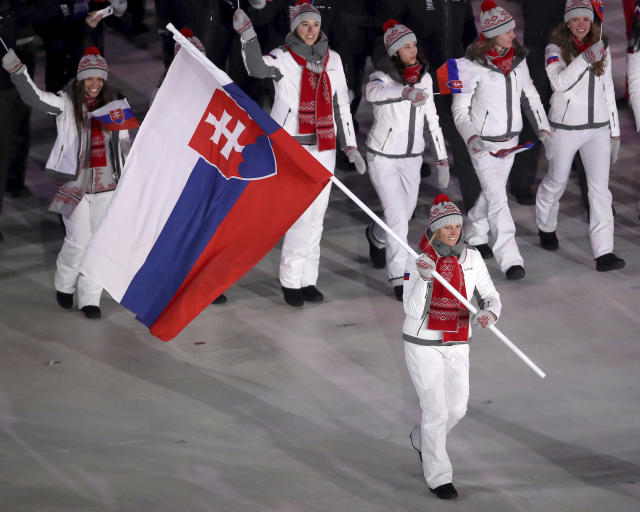 <p>Veronika Velez Zuzulova carries the flag of Slovakia during the opening ceremony of the 2018 Winter Olympics in Pyeongchang, South Korea, Friday, Feb. 9, 2018. (Sean Haffey/Pool Photo via AP) </p>