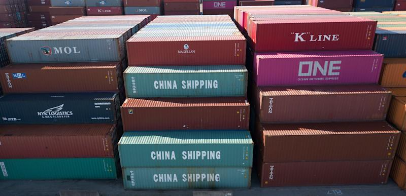 China Shipping Company containers are stacked at the Virginia International's terminal in Portsmouth, Va., Friday, May 10, 2019. President Donald Trump's latest tariff hike on Chinese goods took effect Friday and Beijing said it would retaliate, escalating a battle over China's technology ambitions and other trade tensions. (AP Photo/Steve Helber)