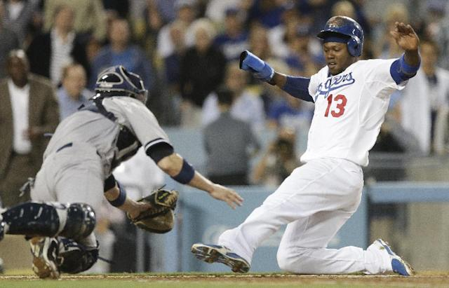 New York Yankees catcher Chris Stewart, left, tags Los Angeles Dodgers' Hanley Ramirez at the plate as Ramirez treid to score on a hit by A.J. Ellis during the third inning of a baseball game in Los Angeles, Tuesday, July 30, 2013. (AP Photo/Chris Carlson)
